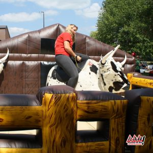 Woman on Mechanical Bull outdoors.